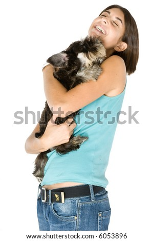 Pretty owner hugging her puppy