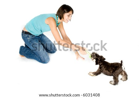 Pretty owner playing with her puppy