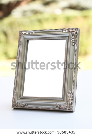 Pretty picture frame with nature background - stock photo