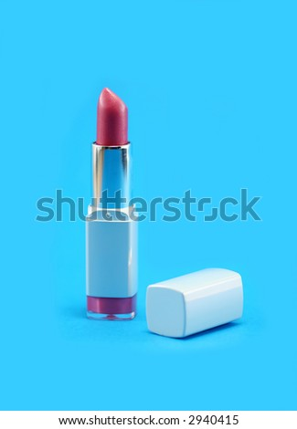 Pretty pink lipstick on a bright blue background