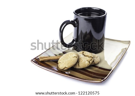 pretty plate of ginger molasses cookies with a cup of coffee - stock photo