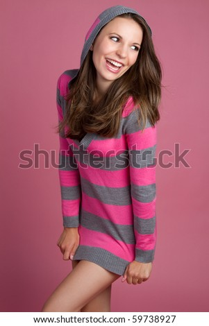 Pretty playful laughing brunette girl - stock photo