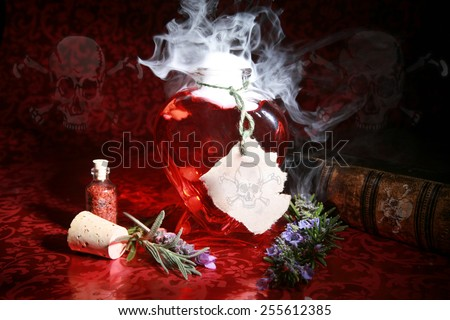Pretty Poison. A Witches Brew boils and bubbles in a heart shaped bottle, with Skull and Cross Bones on the label, Book of Spells and Recipes, along with on the walls in this spooky image. - stock photo