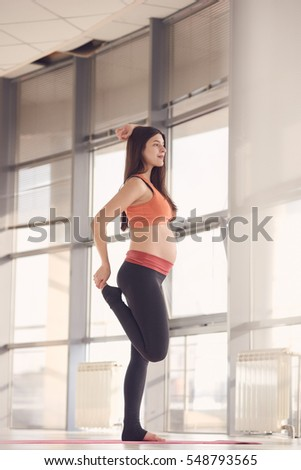 pretty pregnant woman doing exercise