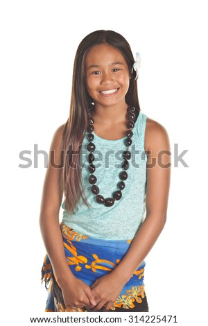 Pretty preteen Filipino girl smiles brightly with the spirit of aloha