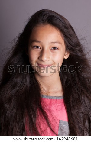 Pretty preteen girl smiling at camera - stock photo