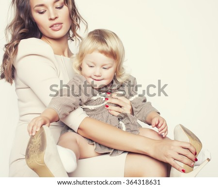 pretty real fashion mother with cute blond little daughter close up smiling happy - stock photo