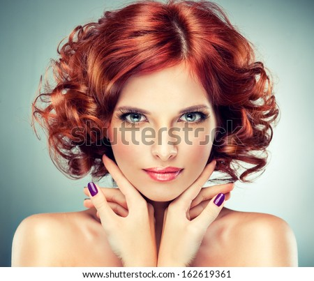 pretty red-haired girl with curls - stock photo