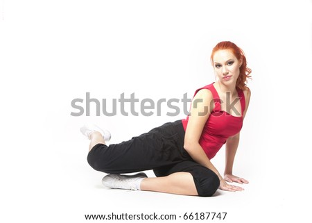 Pretty red-haired lady doing sport in her gym clothes