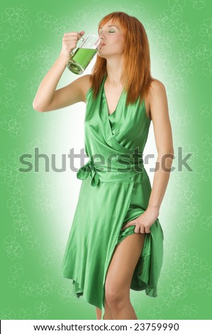 pretty redhaired girl wearing green dress drinking green beer
