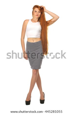 Pretty redhead woman posing, isolated on white background - stock photo