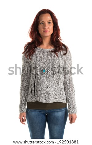Pretty redheaded woman in a gray sweater and jeans
