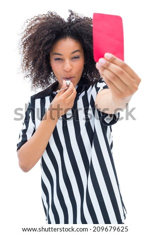 Pretty referee blowing her whistle and showing red card on white background - stock photo