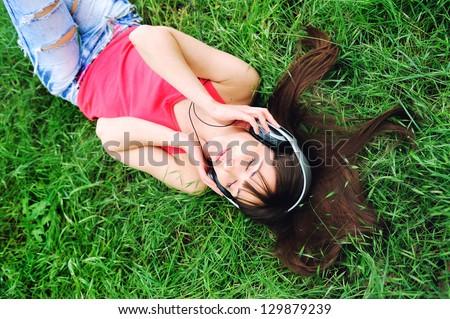 Pretty relaxing girl listen music. - stock photo