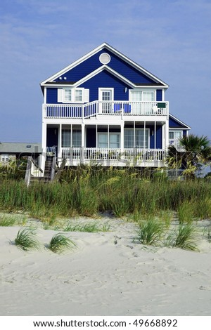 Pretty rental home on the beach - stock photo