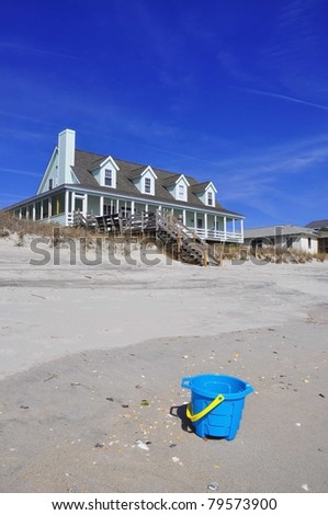 Pretty row of beach rentals - stock photo