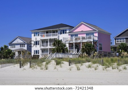 Pretty row of oceanfront rentals at the beach - stock photo
