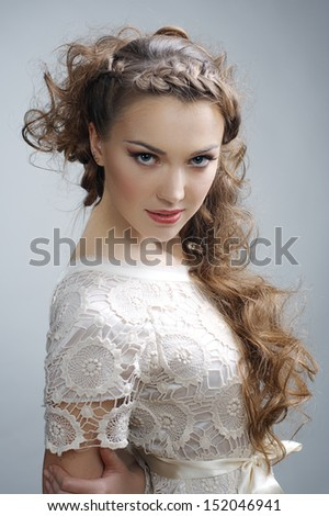 Pretty russian woman with curly hair - stock photo