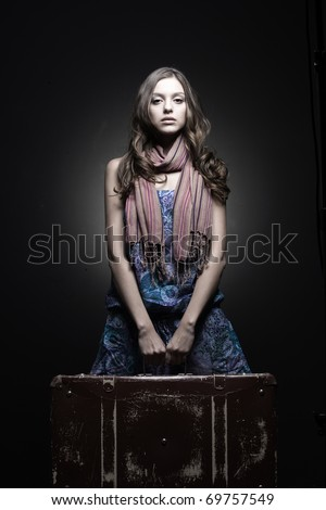 pretty sad girl waiting train or plane with her baggage wave goodbye - stock photo
