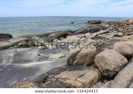 Pretty  scenic view of the rocky  coastline with seaweed of the cold  Southern Ocean  at remote isolated  Flinder's Bay, Augusta, South Western Australia on a cloudy day in late spring.