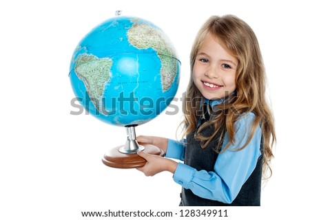 Pretty school girl kid holding globe in her hand, education concept. - stock photo