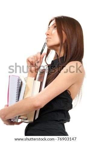 Pretty School girl thinking, holding stack of books, notebook, copy-book and a pen near the head ready for college classes on a white background - stock photo