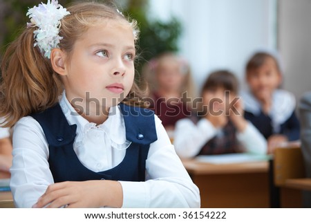 Pretty Schoolgirl in the classroom. Real lesson. - stock photo