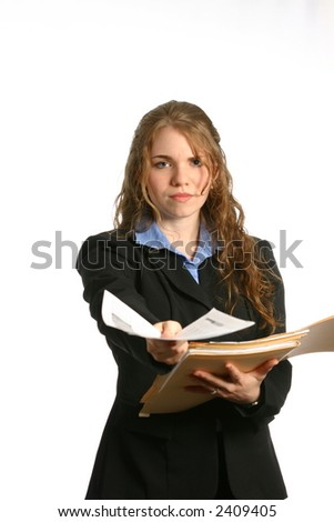 Pretty secretary or businesswoman handing papers over from file - stock photo