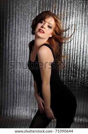 Pretty seductive model woman dancing to the music at disco - stock photo