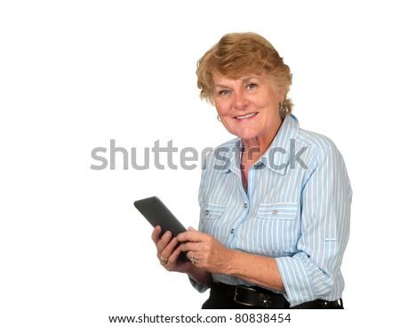 Pretty Senior Citizen Woman Enjoying Her Electronic Book - stock photo