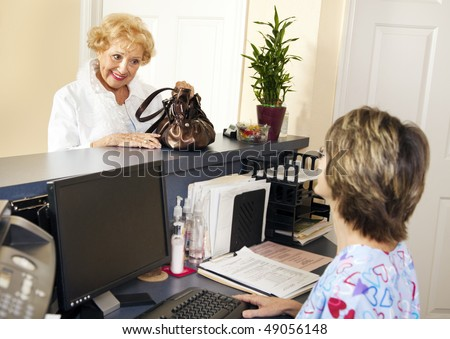 Pretty senior patient checking out of the doctors office. - stock photo