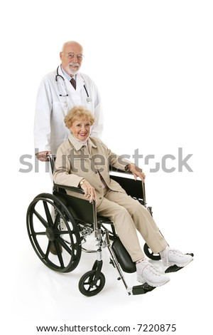 Pretty senior woman in a wheelchair being pushed by her doctor.  Full body isolated on white. - stock photo