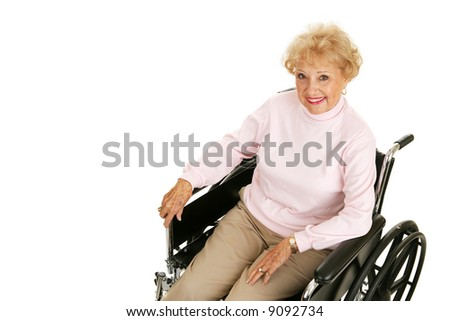 Pretty senior woman with positive attitude in a wheelchair.  Isolated on white with room for text. - stock photo
