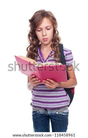 pretty serious girl reading the book. isolated on white background - stock photo