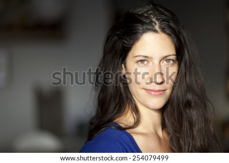 Pretty Serious Woman Looking At The Camera - stock photo