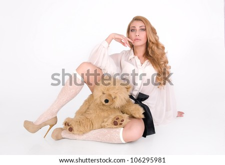 Pretty sexy blond woman sit with furry teddy - stock photo