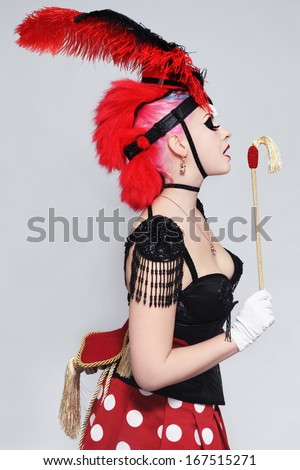 Pretty sexy burlesque girl in fancy costume of horse - stock photo