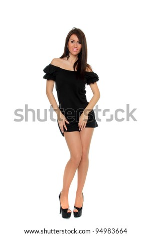 Pretty sexy girl full length posing in a nice black dress isolated over white background - stock photo