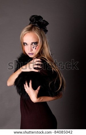 pretty sexy girl makeup as a witch for Halloween is looking straight,  halloween party, halloween costume, halloween witch, woman Halloween, scary halloween, spooky halloween image, vampire woman - stock photo