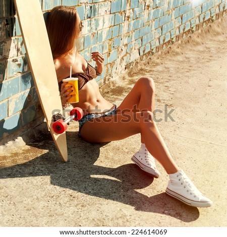 Pretty sexy sport style woman in bikini posing outdoor in summer and have fun  - stock photo