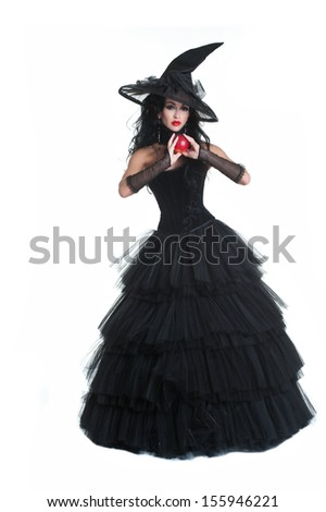 Pretty sexy young brunette witch with a broom, isolated against white background. Halloween - stock photo