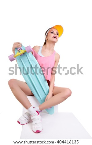pretty sexy young seductive woman posing with longboard desk on white background