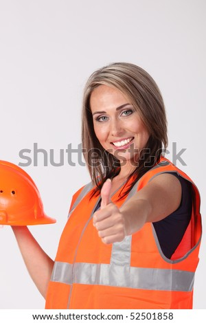 Pretty sexy young woman construction worker contractor with tools and hard hat - stock photo
