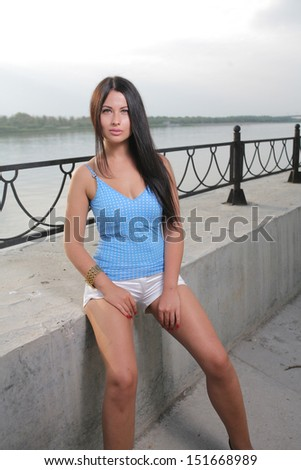 Pretty sexy young woman enjoy the breeze outdoor in a summer day vertical shot - stock photo