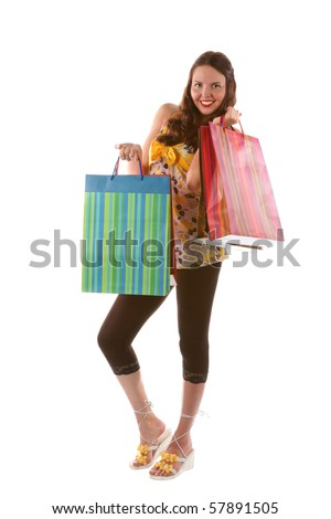 Pretty shopping girl with bags - stock photo