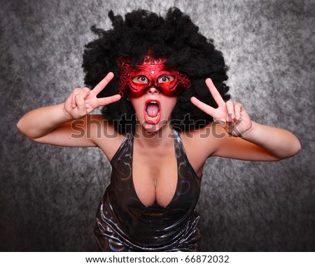 Pretty showgirl with red mask and afro hair-style dancing on the carnival - stock photo