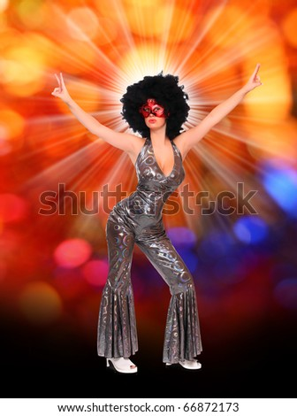 Pretty showgirl with red mask and afro hair-style dancing on the carnival. Great for New Year greetings - stock photo