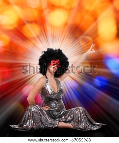Pretty showgirl with red mask and afro hair-style dancing on the carnival. Great for New Year greetings. - stock photo