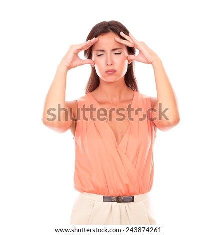 Pretty sick girl with hand on head and closed eyes gesturing pain or headache in white background