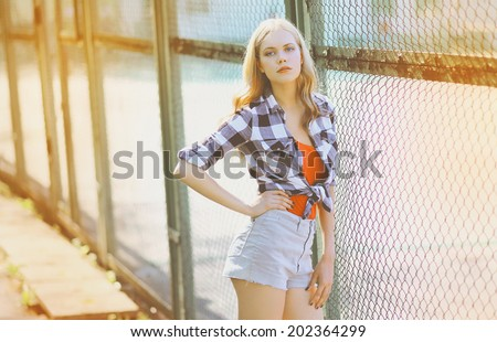Pretty slim model posing in the city, hipster girl, street fashion - stock photo